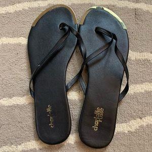 Charlotte Russe Black and Gold Flip Flop Sandals